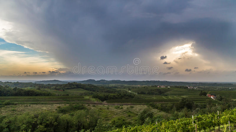 Storm over the fields. A storm is growin up over the fields of italy stock photo