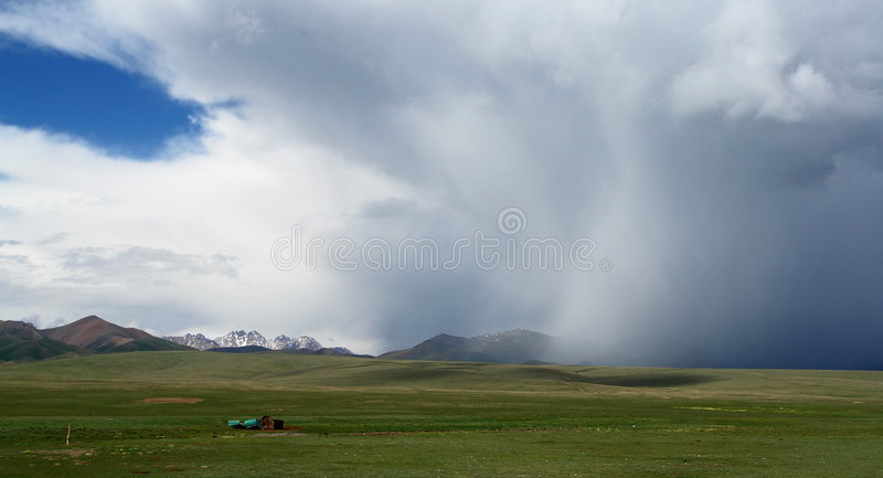 Storm over green fields royalty free stock photography