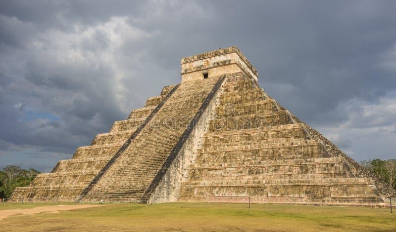 Storm over Kukulkan mayan pyramid in Chichen Itza stock photo