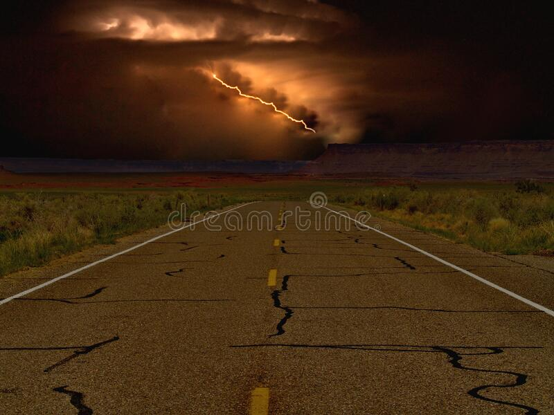 Dark Desert Highway Storm. A storm over a lonely desert highway located in southern Utah near the small town of Mexican Hat royalty free stock image