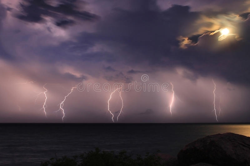 The storm over the ocean. Moonlight stock photography