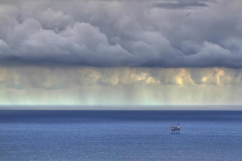 Storm over the sea. Storm over the North Sea in Spain with oil rig in the background royalty free stock photos