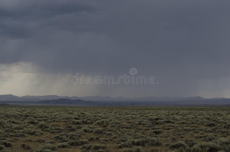 Storm on Plains. A dense storm moves over the plains of Wyoming stock photos