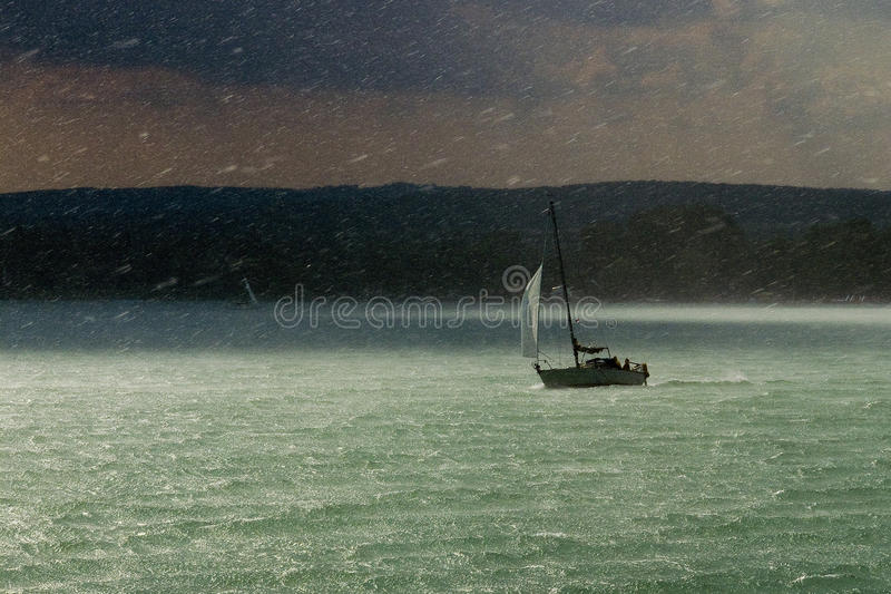 Storm, rain and sailboat royalty free stock photo
