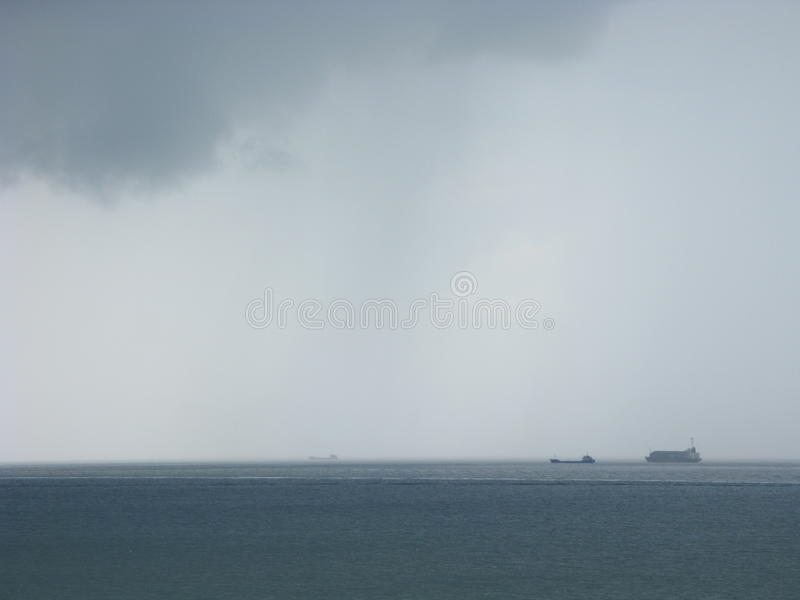 Storm at sea with freighters approaching stock photos