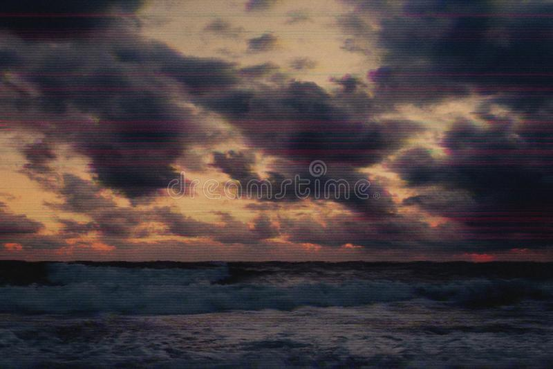 Storm on the sea in the glitch effect. Storm at sea and dramatic sky in glitch effect royalty free stock photo