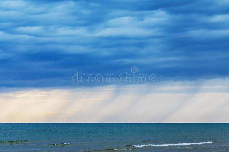 Storm on the sea with rain clouds stock photo