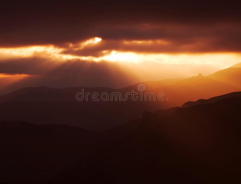 Storm sunset in mountain stock photo