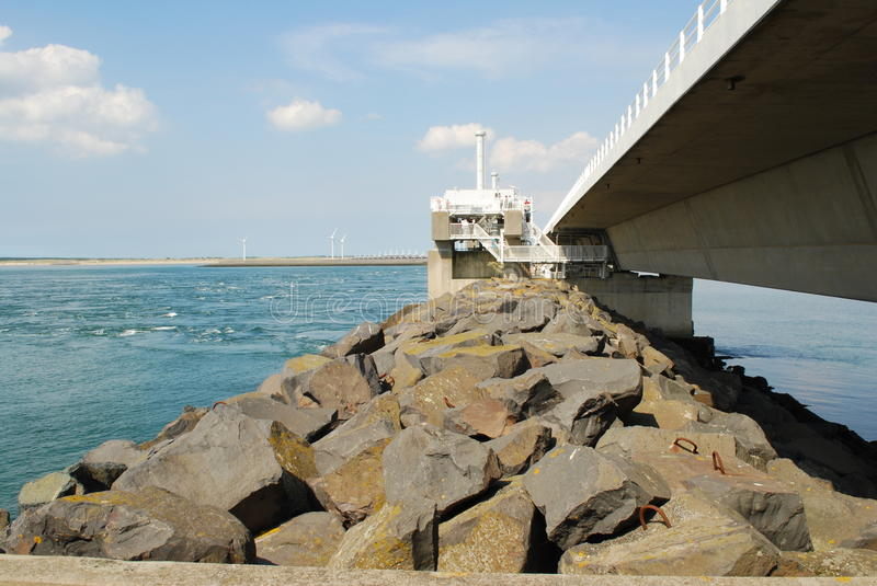 Storm surge barrier. Oosterschelde storm surge barrier along the Dutch coast in the province of Zeeland royalty free stock photo