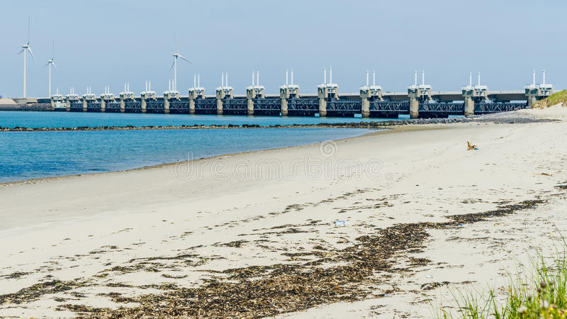 Storm surge barrier Oosterschelde nearby Neeltje Jans in The Net. The storm surge barrier Oosterschelde nearby Neeltje Jans in The Netherlands royalty free stock photos