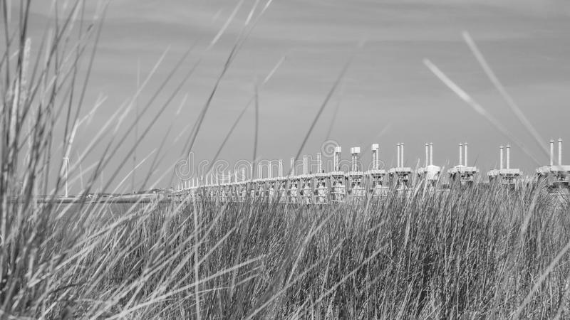 Storm surge barrier Oosterschelde nearby Neeltje Jans in The Net. The storm surge barrier Oosterschelde nearby Neeltje Jans in The Netherlands royalty free stock image