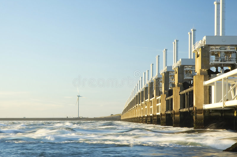 Storm surge barrier in Zeeland. Holland. Build after the storm disaster in 1953. Long shutter speed, waves are flowing royalty free stock photo