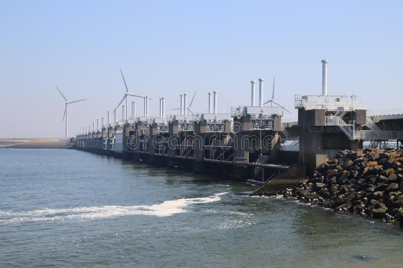 Storm surge barriers named Oosterscheldekering to protect part of the Netherlands with a length n. Storm surge barriers named Oosterscheldekering to protect part royalty free stock images