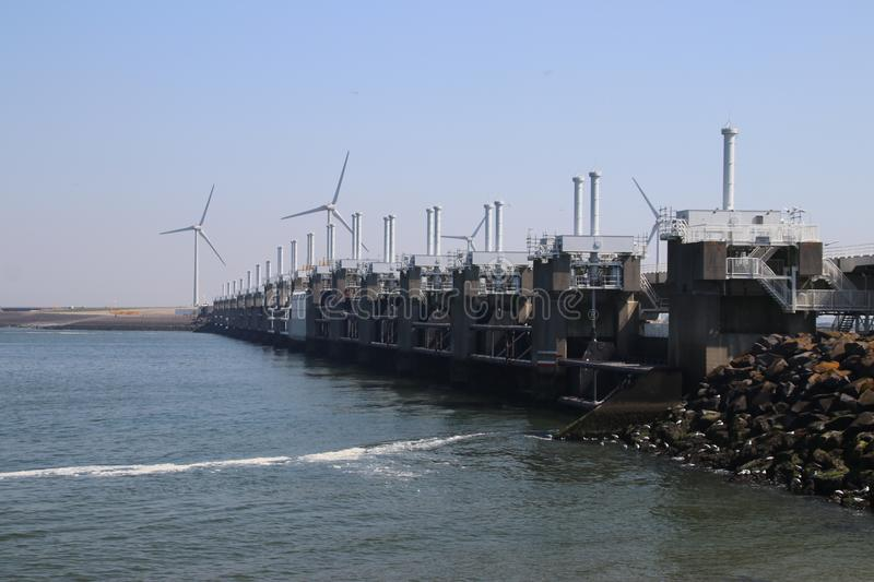 Storm surge barriers named Oosterscheldekering to protect part of the Netherlands with a length. Og 9 kilometers. These are part of the Dutch Deltawerken stock image