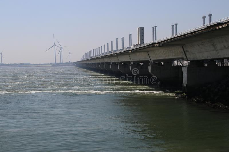 Storm surge barriers named Oosterscheldekering to protect part of the Netherlands with a length og 9 kilometers. These are part of the Dutch Deltawerken stock image