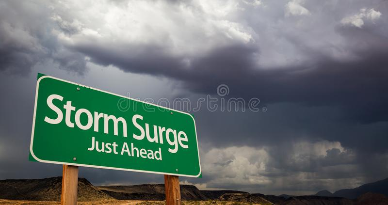 Storm Surge Just Ahead Green Road Sign and Stormy Clouds. Storm Surge Just Ahead Green Road Sign with Dramatic Clouds and Rain royalty free stock image