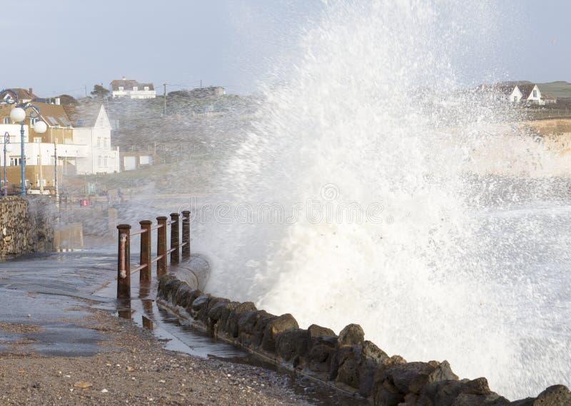 UK Storm surge Isle of Wight. Waves crashing against sea wall at Freshwater bay, Isle of WIght UK stock images
