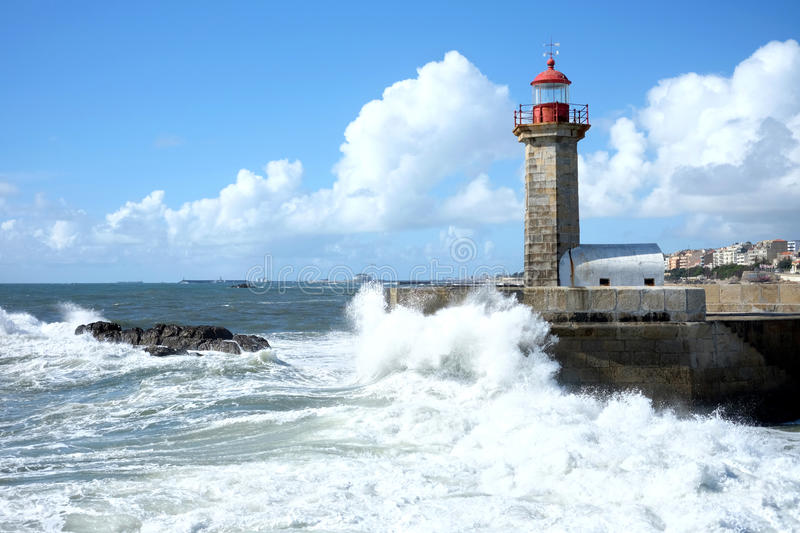 Storm waves over lighthouse in Porto, Portugal royalty free stock photo