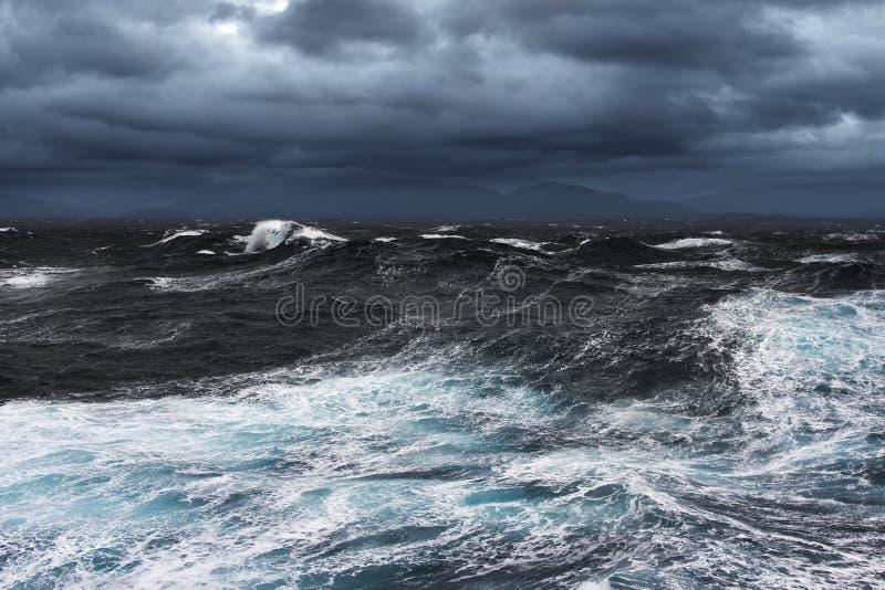 Storming Seas. And Mountains in the Horizon stock photos