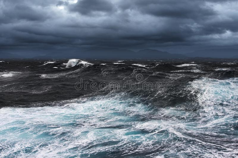Storming Seas. And Mountains in the Horizon royalty free stock image