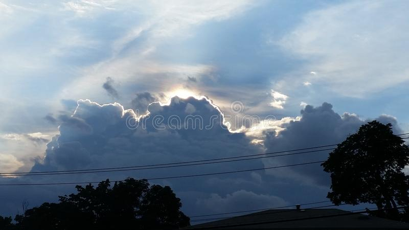 Storms brewing. Angry clouds. Storm. Grey. White. Sun. Rays royalty free stock photography