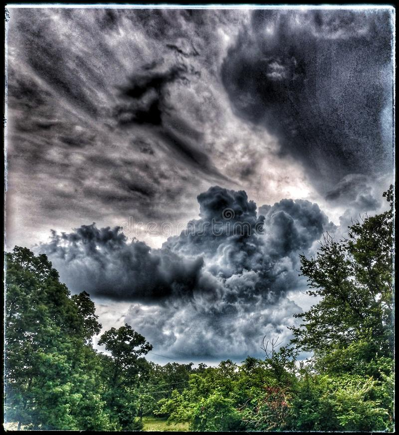 Storms. Clouds, nature, trees, country, sky, storms stock image