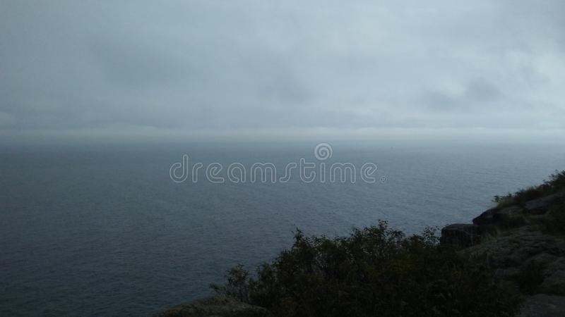 Storms are Coming. Storm storms coming gray sky graysky cloudy cloudyday cliff stock photography