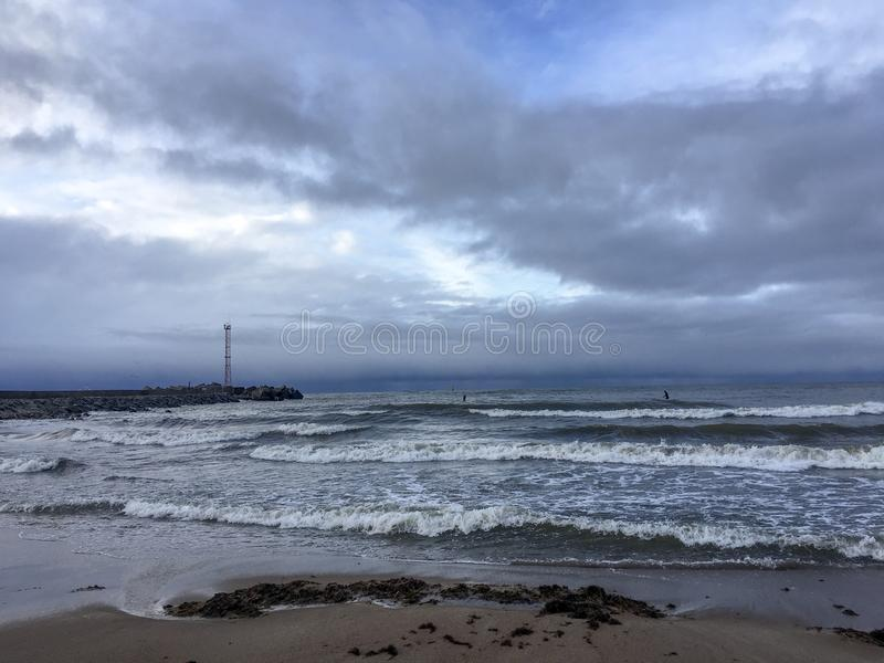 Stormy batic day in Klaipeda, Lithuania. Close to Norhtern vawe breaker and port entrance royalty free stock photography