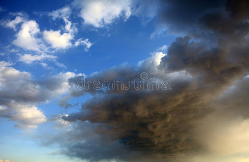 Stormy clouds. Natural backgrounds. Heavy massive stormy clouds royalty free stock photos