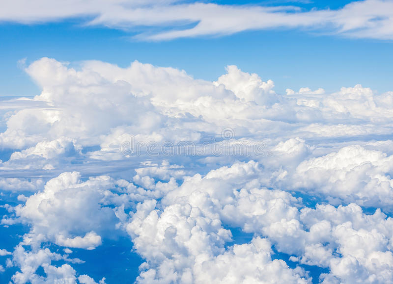 Stormy clouds in blue sky cloudscape, view over the white fluffy stock image