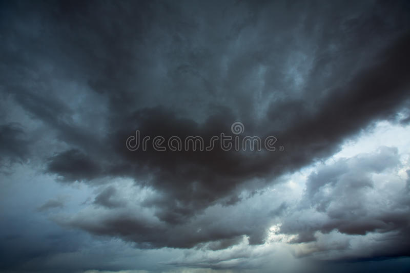Stormy clouds gray sky with dramatic shadows stock photo