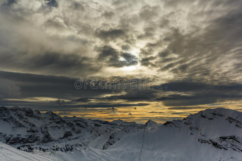 Download Stormy Clouds Over A Snowcaped Mountain Range Stock Photo - Image: 83715228