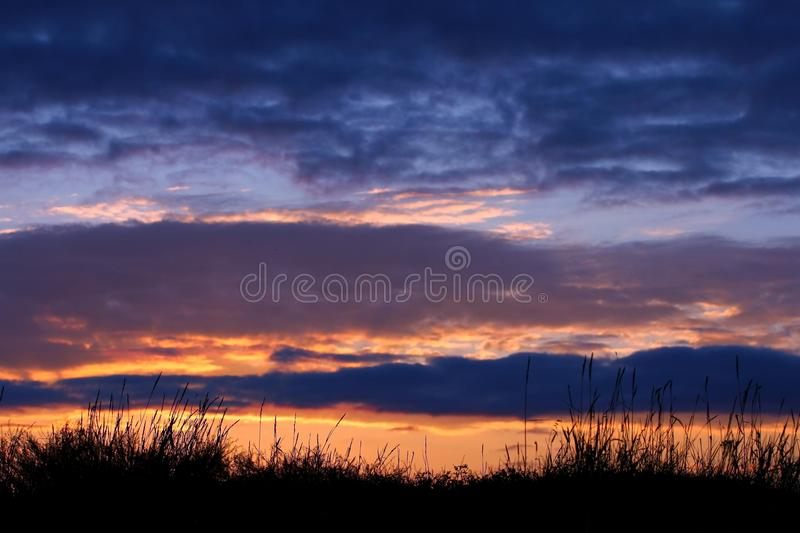 Stormy clouds on sunset sky. Summer sunset with dramatic clouds stock image