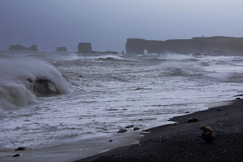 Storm on the black beach of iceland. Stormy day with clouds and waves on the coast oficeland near hof royalty free stock photo