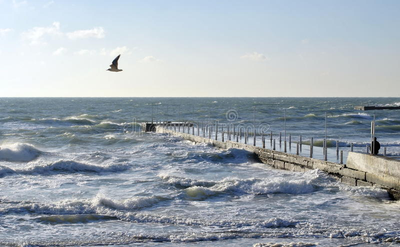 Stormy day in October in Black Sea. Sea wave splashing against a pier in Odessa. Black Sea stock images