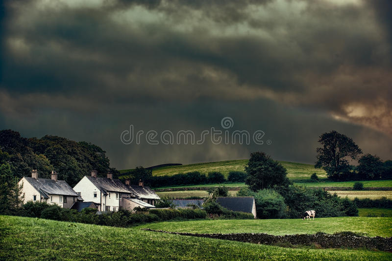 Stormy Hamlet. Rural hamlet with stormy skies stock photo