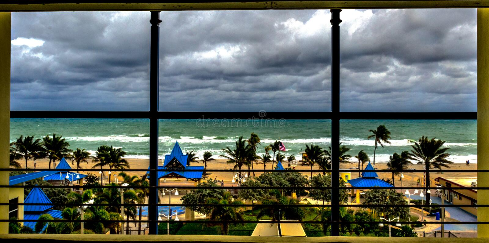 Stormy Hollywood Beach. This photo was taken from inside the parking garage looking out onto a stormy day at Hollywood Florida Beach royalty free stock photos