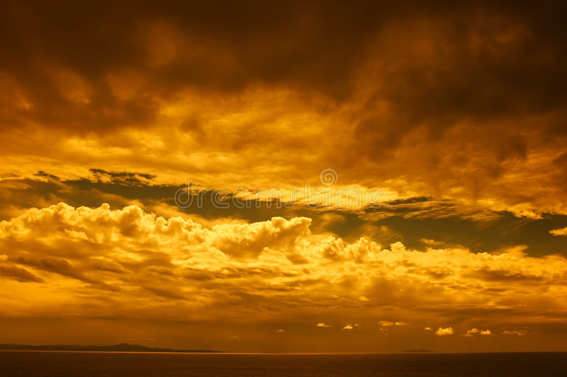 Stormy landscape. Dramatic stormy landscape, clouds over sea with yellow filter royalty free stock images