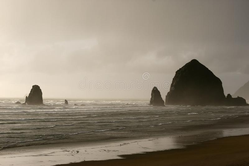 Stormy and Moody Haystack Rock stock photography