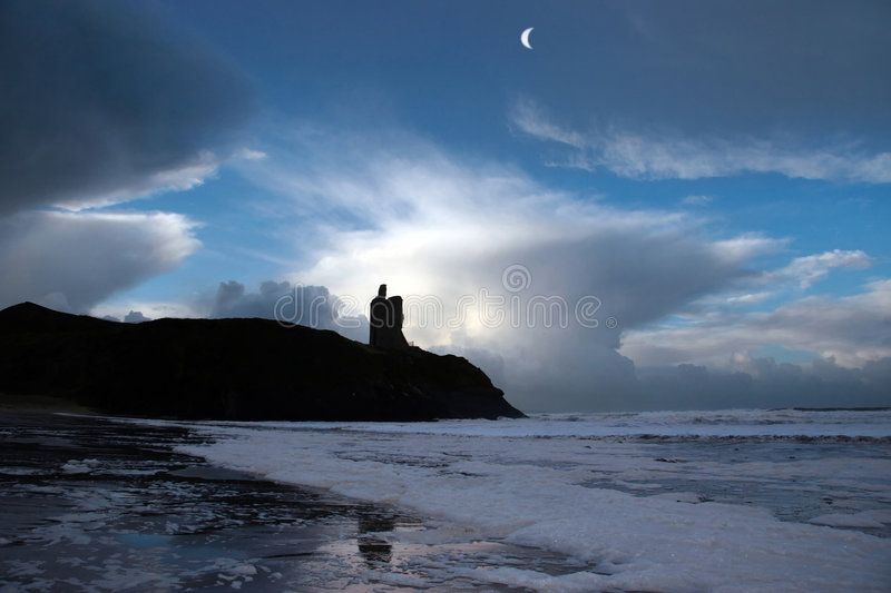 Stormy night 3. Ballybunion castle ireland after a winters storm royalty free stock photos
