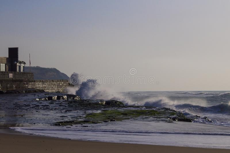 Stormy ocean waves. Crashing against the breakwater royalty free stock photos