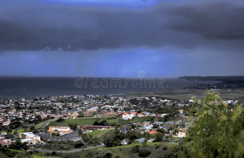 Stormy San Clemente. A storm passes through San Clemente with rain in the background royalty free stock photo
