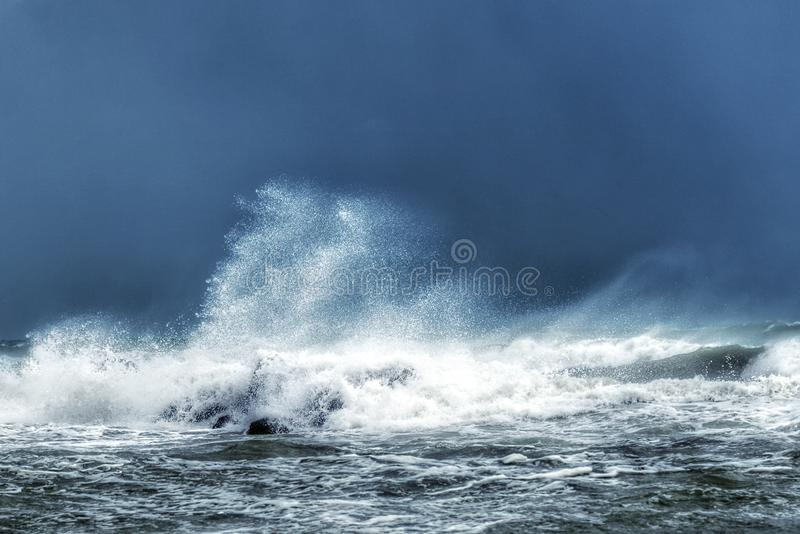 Stormy sea and high waves. Stormy sea with high waves and splashing water royalty free stock image