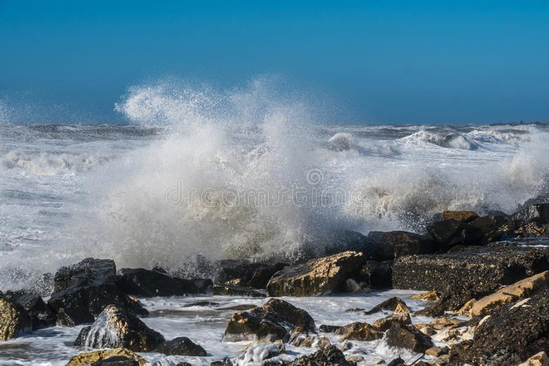 Stormy sea huge waves breaking near the coast stock photo