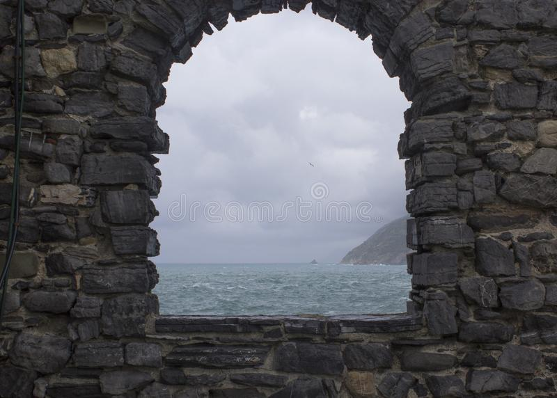 Stormy sea seen from a window stock photos