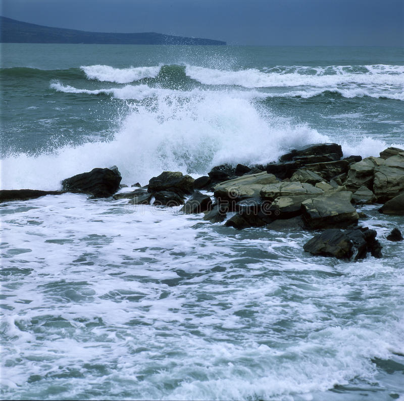 Stormy sea waves. Crash into the rocks royalty free stock photos