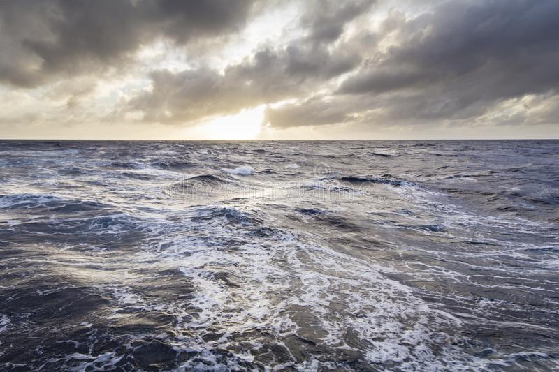 Cruising at Stormy seas stock images