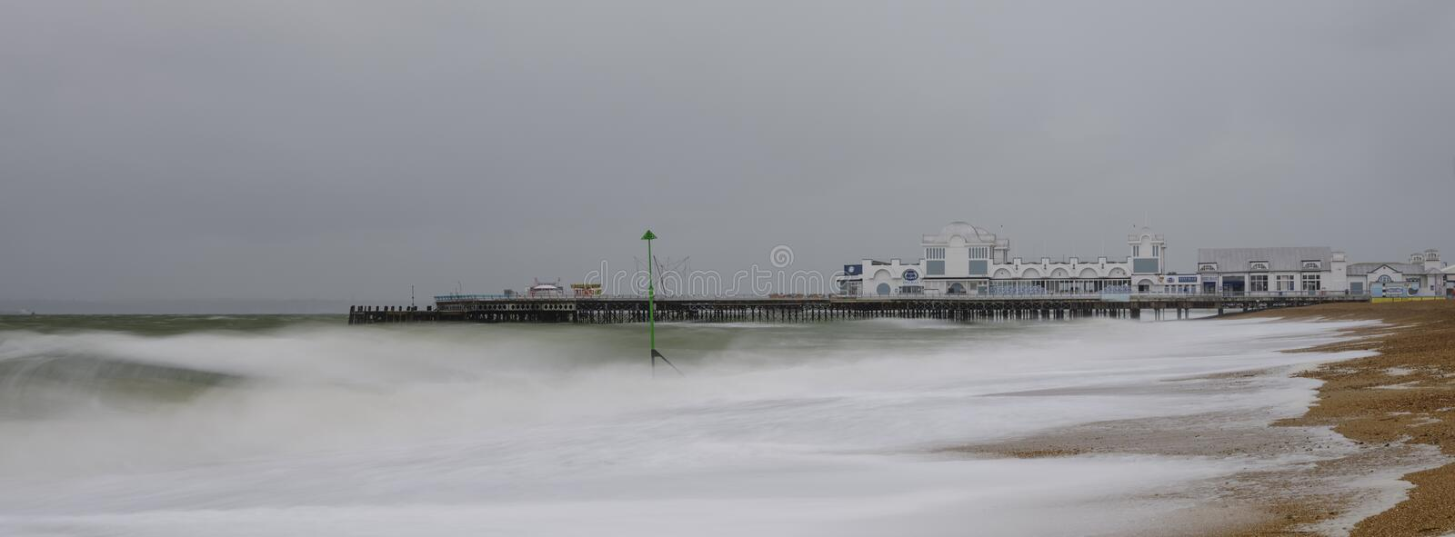 Stormy seas, slow shutter speed and Southsea Pier, Hampshire, UK. Southsea, UK - April 4, 2019:  Stormy seas, slow shutter speed and Southsea Pier, Hampshire, UK stock photos