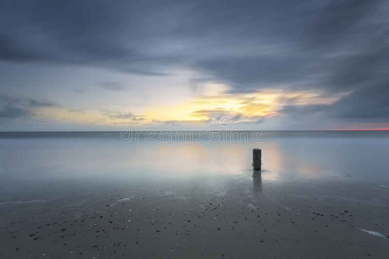 Stormy Seascape Sunset In Long Exposure royalty free stock photo