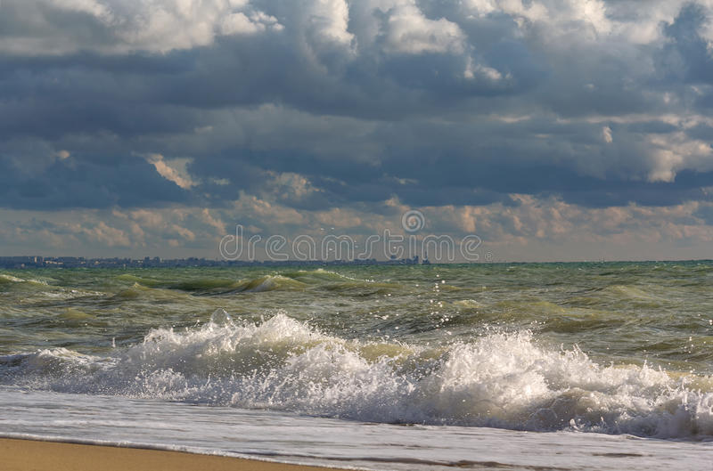 Stormy skies over the sea and the city of Sevastopol on the horizon. Crimean Black sea coast stock images